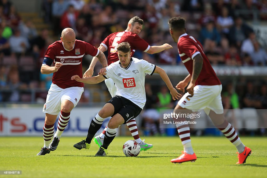 Jamie Hanson of Derby County takes on the Northampton Town defenders during the Pre-Season Friendly match between Northampton Town and Derby County at Sixfields Stadium on July 18, 2015 in Northampton, England.