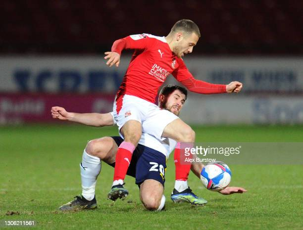 Jamie Hanson of Oxford United tackles Jack Payne of Swindon Town during the Sky Bet League One match between Swindon Town and Oxford United at County...