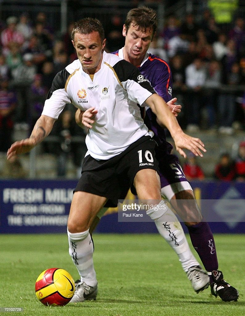 Jamie Harnwell of the Glory and Sean Devine of the Knights contest the ball during the round seven Hyundai A-League match between Perth Glory and the New Zealand Knights at Members Equity Stadium October 6, 2006 in Perth, Australia.