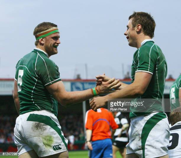 Jamie Heaslip of Ireland celebrates his try with team mate Tommy Bowe of Ireland during the International Friendly match between the Barbarians and...