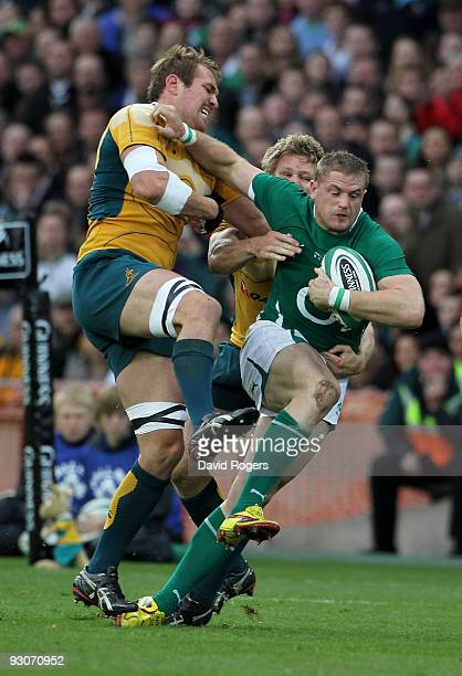 Jamie Heaslip of Ireland holds off Rocky Elsom during the rugby union international match between Ireland and Australia at Croke Park on November 15...