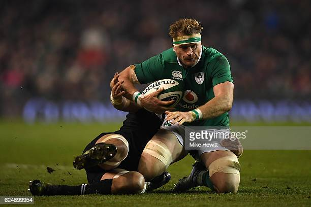 Jamie Heaslip of Ireland is brought to his knees by Ardie Savea of New Zealand during the International Friendly between Ireland and New Zealand at...
