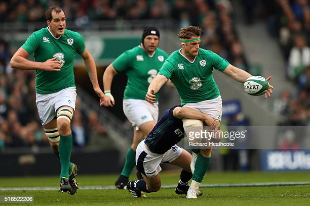 Jamie Heaslip of Ireland knocks on in the tackle during the RBS Six Nations match between Ireland and Scotland at the Aviva Stadium on March 19 2016...