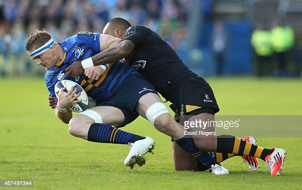 Jamie Heaslip of Leinster is tackled by Sailosi Tagicakibau during the European Rugby Champions Cup match between Leinster and Wasps at the RDS Arena...