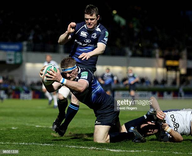 Jamie Heaslip the Leinster number 8 dives over to score a try during the Heinken Cup quarter final match between Leinster and Clermont Auvergne at...