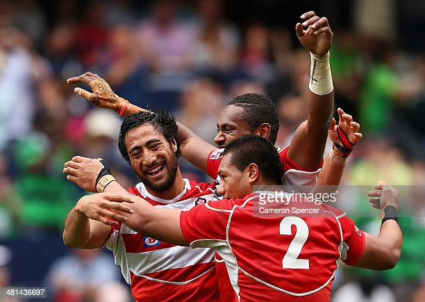 Jamie Henry Lomano Lemeki and Lote Tuqiri of Japan celebrate winning the Qualifying semifinal match between Japan and Russia during the 2014 Hong...