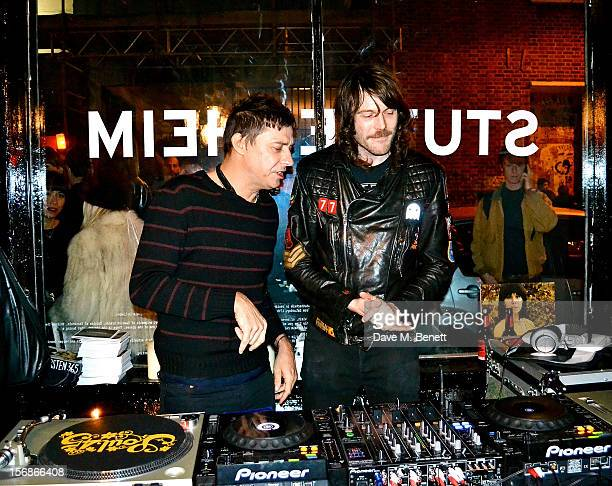 Jamie Hince and DJ Tim Rockins attend the launch of the Stutterheim Raincoats pop up shop in Shoreditch on November 22 2012 in London England