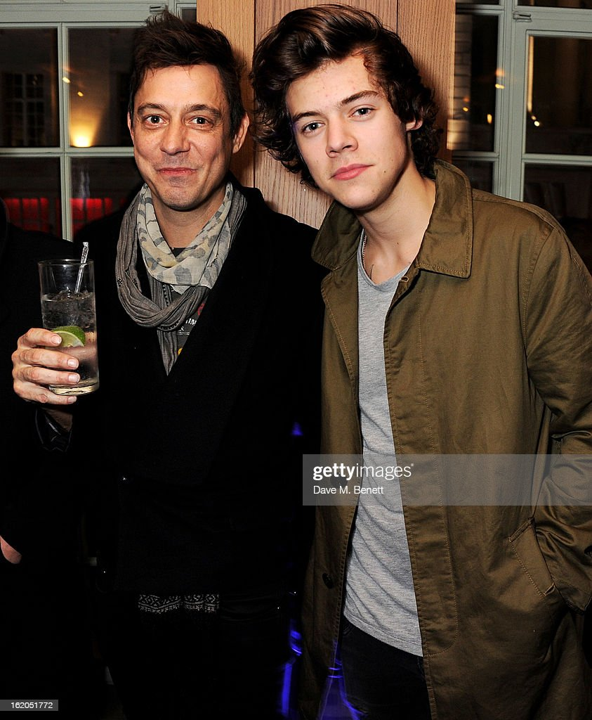 Jamie Hince (L) and Harry Styles attends the AnOther Magazine and Dazed & Confused party with Belvedere Vodka at the Cafe Royal hotel on February 18, 2013 in London, England.