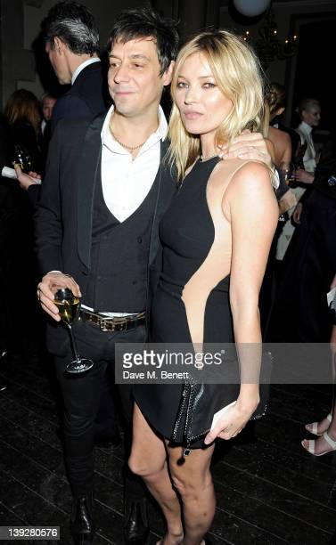 Jamie Hince and Kate Moss attend a cocktail reception at the Stella McCartney Special Presentation during London Fashion Week Autumn/Winter 2012 a...