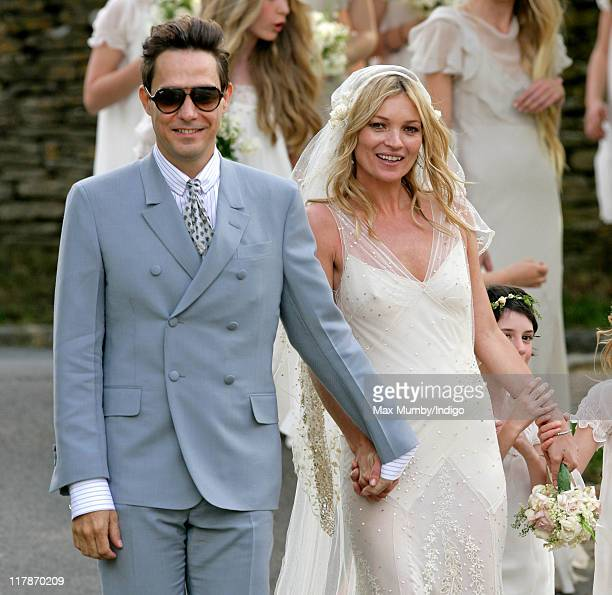Jamie Hince and Kate Moss pose for photographs as they leave St Peter's Church after their wedding on July 1 2011 in Abingdon England
