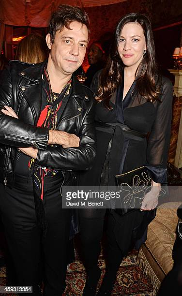 Jamie Hince and Liv Tyler attend a party hosted by David Beckham and Alister Mackie to celebrate Another Man Magazine at Mark's Club on November 20...
