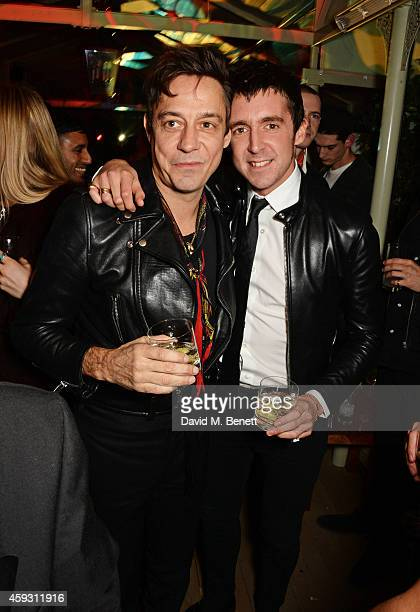 Jamie Hince and Miles Kane attend a party hosted by David Beckham and Alister Mackie to celebrate Another Man Magazine at Mark's Club on November 20...