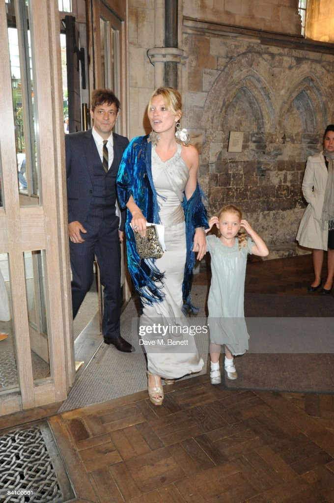 Jamie Hince, Kate Moss and daughter Lila Grace attend the wedding of Leah Wood and Jack MacDonald at Southwark Cathedral on June 21, 2008 in London, England.