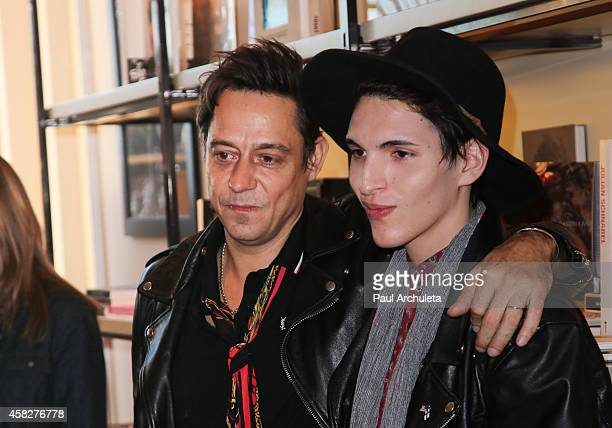 Jamie Hince of the Rock Band Kills signs for fans copies of his new book 'Echo Home' at BookMarc on November 1 2014 in Los Angeles California