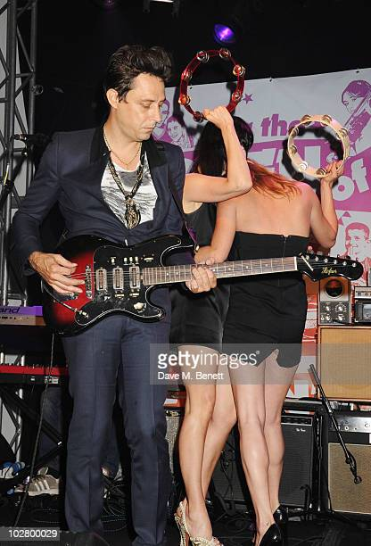 Jamie Hince Susie Bick and Kate Moss perform at a benefit evening for The Hoping Foundation on July 10 2010 in London England