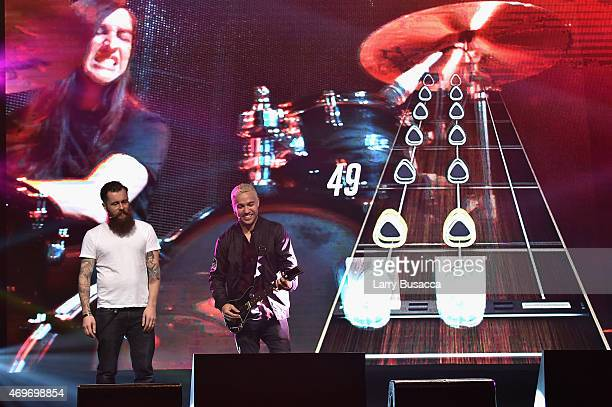 Jamie Jackson creative director and cohead of freestyle games and musician Pete Wentz play Guitar Hero Live on stage at the revealing of the AllNew...