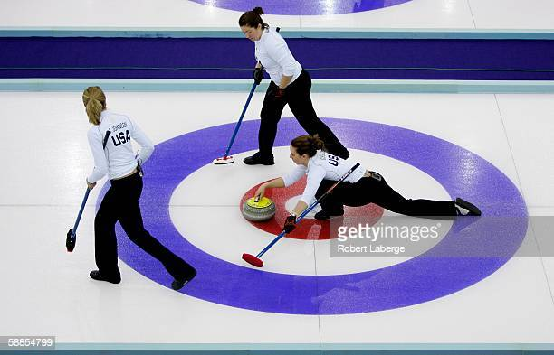 Jamie Johnson Maureen Brunt and Jessica Schultz of the United States compete in the preliminary round of the women's curling between Denmark and USA...
