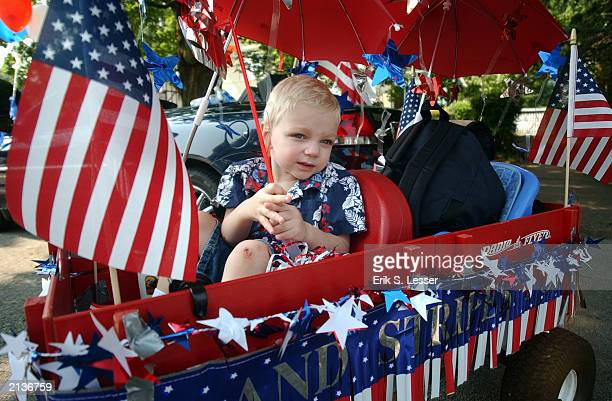 Jamie Joiner enjoys his patriotic ride during the Avondale Estates July 4th Parade in Avondale Estates Georgia July 4 2003