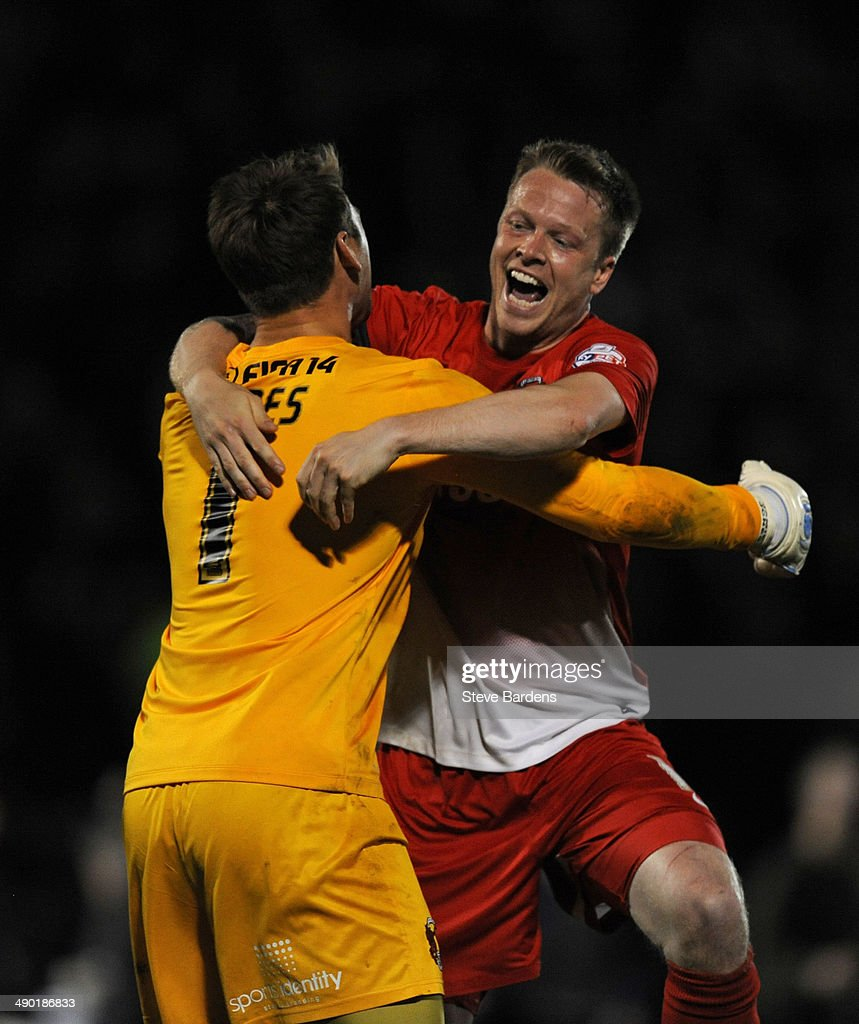 Jamie Jones and Nathan Clarke of Leyton Orient celebrate after victory in the Sky Bet League One play-off second leg semi-final match between Leyton Orient and Peterborough United at Matchroom Stadium on May 13, 2014 in London, England.