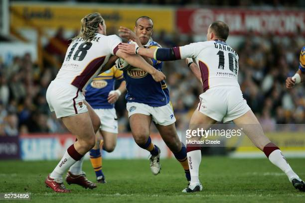 Jamie Jones Buchanan of Leeds sandwiched between Eorl Crabtree and Jim Gannon during the Engage Super League match between Leeds Rhinos and...