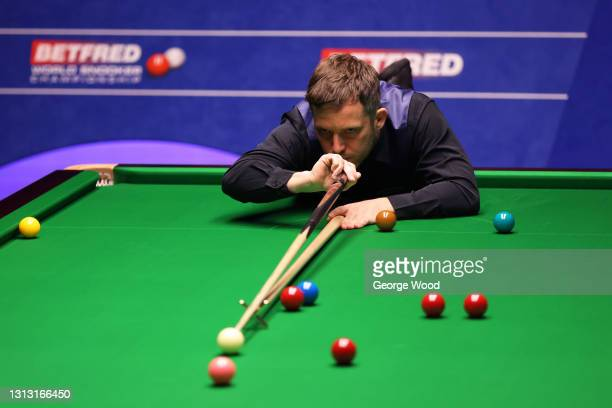 Jamie Jones of Wales plays a shot during the Betfred World Snooker Championship Round One match between Jamie Jones of Wales and Stephen Maguire of...