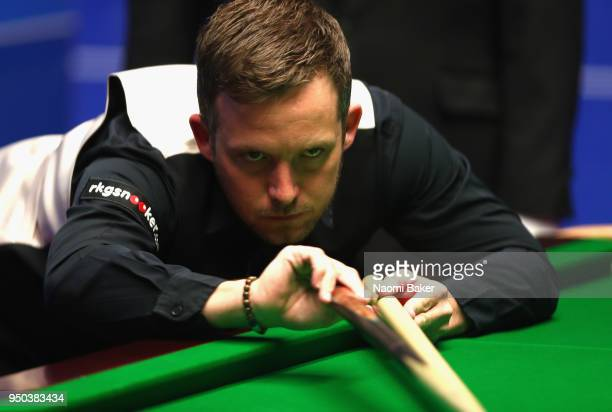 Jamie Jones of Wales takes a shot during his first round match against Shaun Murphy of Wales during day three of the World Snooker Championship at...