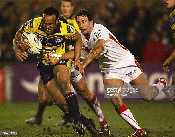 Jamie Jones-Buchanan of Leeds beats the tackle of Lee Gilmour of St Helens during the engage Super League match between St Helens and Leeds Rhinos at...