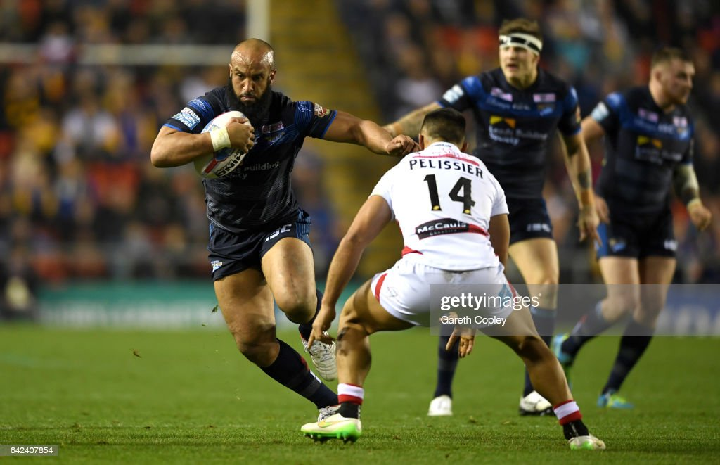 Jamie Jones-Buchanan of Leeds gets past Eloi Pelissier of Leigh during the Betfred Super League match between Leigh Centurions and Leeds Rhinos at Leigh Sports Village on February 17, 2017 in Leigh, Greater Manchester.