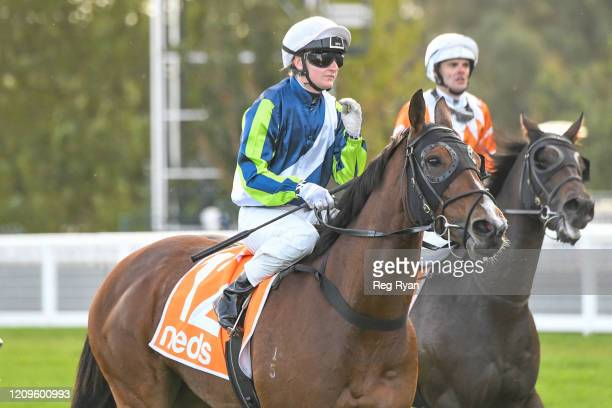 Jamie Kah returns to the mounting yard on Bam's On Fire after winning the Elvis Thurgood 40th Anniversary Cup at Caulfield Racecourse on April 11...