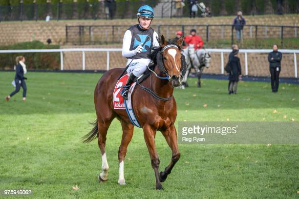 Jamie Kah returns to the mounting yard on Showpero after winning the Epi Café Plate at Moonee Valley Racecourse on June 16 2018 in Moonee Ponds...