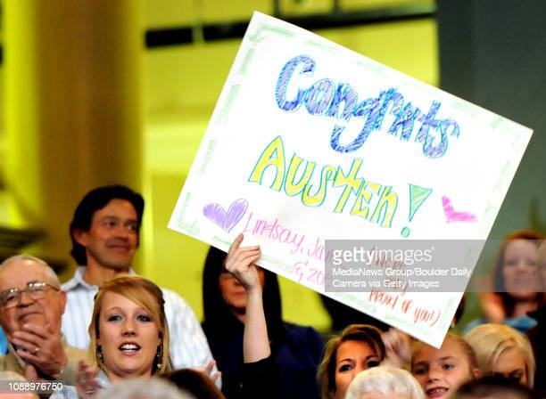 Jamie Kelly holds up a sign for Monarch High School graduate Austin Locke during Monarch's graduation ceremony on Friday May 20 at the Coors Events...