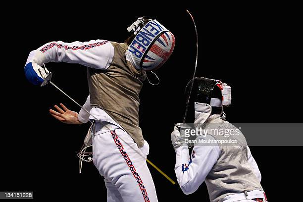 Jamie Kenber of Great Britain in action against Erwaan Le Pechoux of France during the Men's Foil Semi Final Team Event at the Fencing Invitational...
