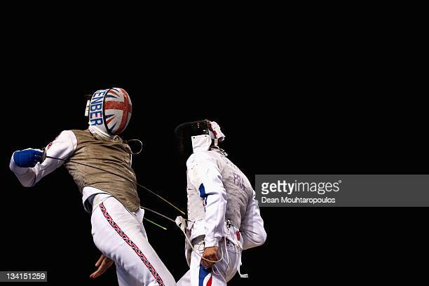 Jamie Kenber of Great Britain in action against Guyart Brice of France during the Men's Foil Semi Final Team Event at the Fencing Invitational part...