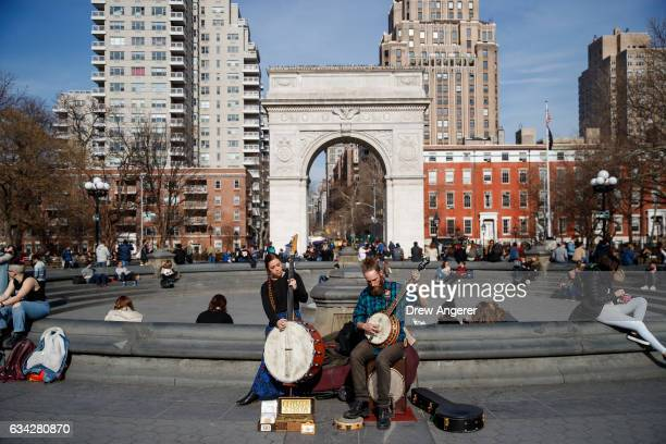 Jamie Kopie and Thomas Kopie play music in Washington Square Park February 8 2017 in New York City As temperatures touched 60 degrees on Wednesday...