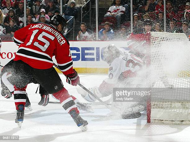 Jamie Langenbrunner of the New Jersey Devils puts the puck past Brian Elliott of the Ottawa Senators for a first period goal during their game at the...