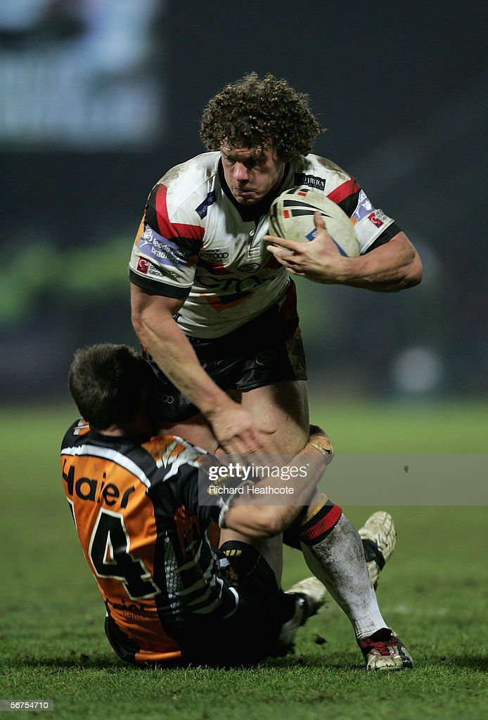 Jamie Langley of Bradford charges through the tackle of Liam Fulton of the Tigers during the Carnegie World Club Challenge between Bradford Bulls and Wests Tigers at the Galpharm Stadium on February 03, 2006 in Huddersfield, England
