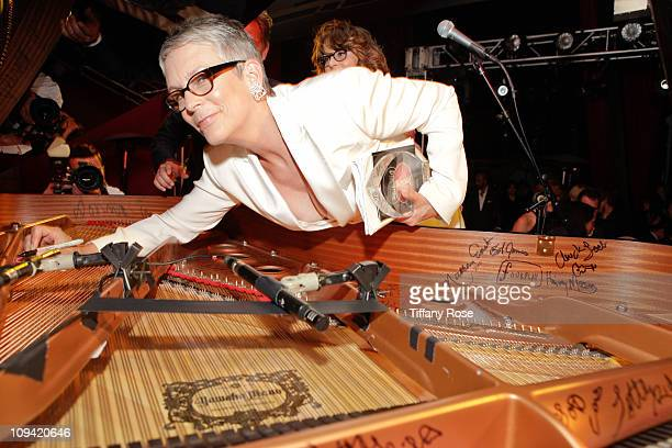 Jamie Lee Curtis autographs the piano at the Leeza Gibbon's Dare 2 Care Benefit at BOA Steakhouse on February 24 2011 in West Hollywood California