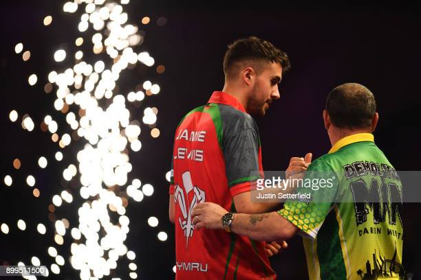 Jamie Lewis celebrates after winning his Quarter Final Match against Darren Webster during the 2018 William Hill PDC World Darts Championships on Day...