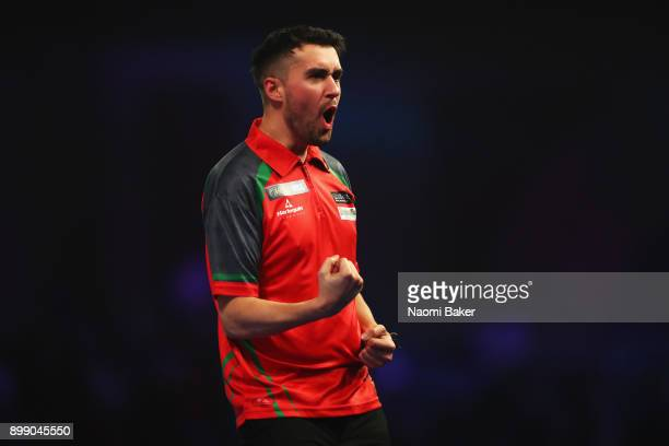 Jamie Lewis of Wales celebrates winning a set during the second round match against Peter Wright of England on day eleven of the 2018 William Hill...