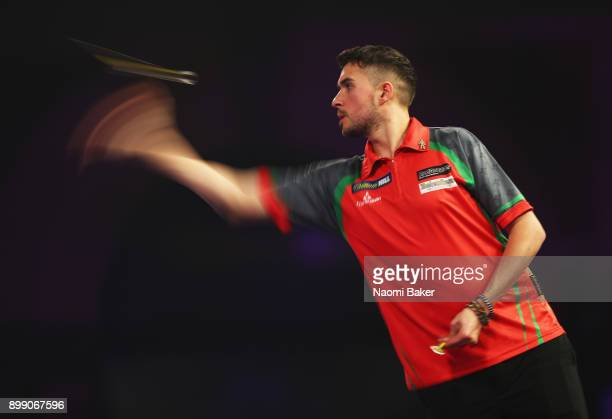 Jamie Lewis of Wales in action during the second round match against Peter Wright of England on day eleven of the 2018 William Hill PDC World Darts...