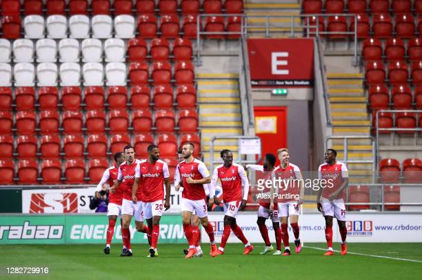 Jamie Lindsay of Rotherham United celebrates with his team mates after scoring his sides first goal during the Sky Bet Championship match between...