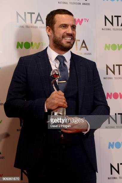 Jamie Lomas from I'm A Celebrity Get Me Out Of Here with the award for Challenge Show attends the National Television Awards 2018 at The O2 Arena on...