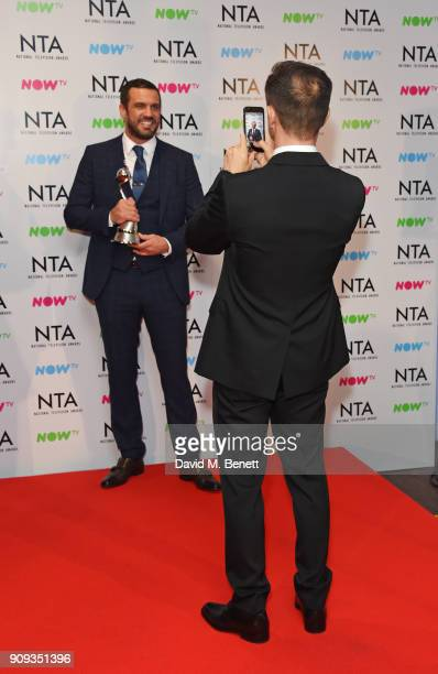 Jamie Lomas poses for Dennis Wise while accepting the Challenge Show award for 'I'm A CelebrityGet Me Out Of Here' in the press room at the National...