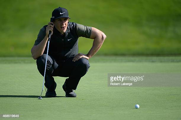 Jamie Lovemark assesses a putt on the 11th hole during the first round of the Farmers Insurance Open on Torrey Pines South on January 23 2014 in La...