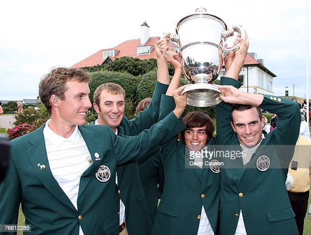 Jamie Lovemark Dustin Johnson Rickie Fowler and Billy Horschell pose with the trophy after the United States team had clinched victory during the...