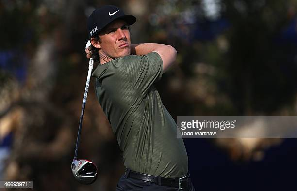 Jamie Lovemark hits a tee shot on the 7th hole during the first round of the Farmers Insurance Open on Torrey Pines South on January 23 2014 in La...
