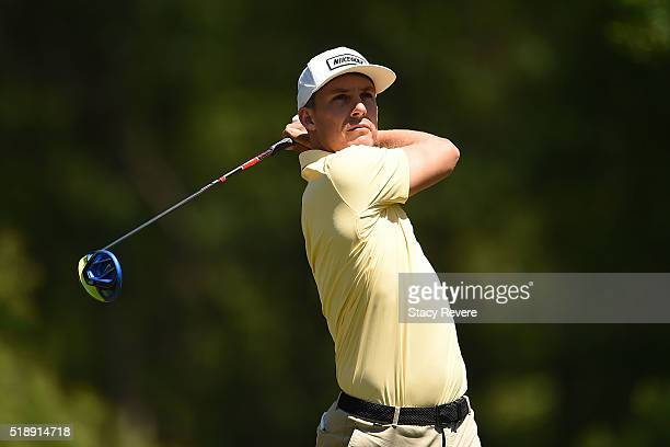 Jamie Lovemark of the United States hits his tee shot on the second hole during the final round of the Shell Houston Open at the Golf Club of...
