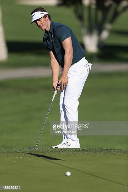 Jamie Lovemark plays the 18th hole at La Quinta Country Club Course during the first round of the Humana Challenge in partnership with the Clinton...