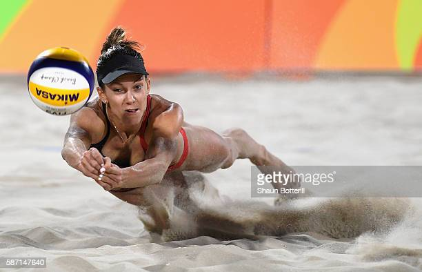 Jamie Lynn Broder of Canada dives for the ball during the Women's Beach Volleyball preliminary round Pool D match against Marta Menegatti and Laura...