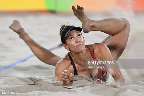 Jamie Lynn Broder of Canada reacts after diving for the ball during the Women's Beach Volleyball preliminary round Pool D match against Marta...